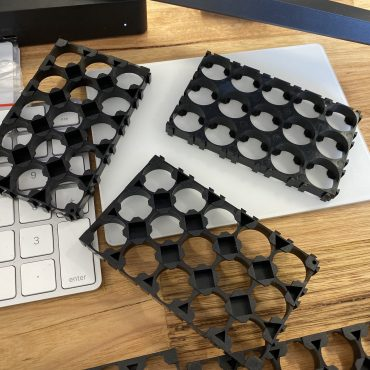 Three individual 3x5 cell holders with a keyboard numpad for size reference.